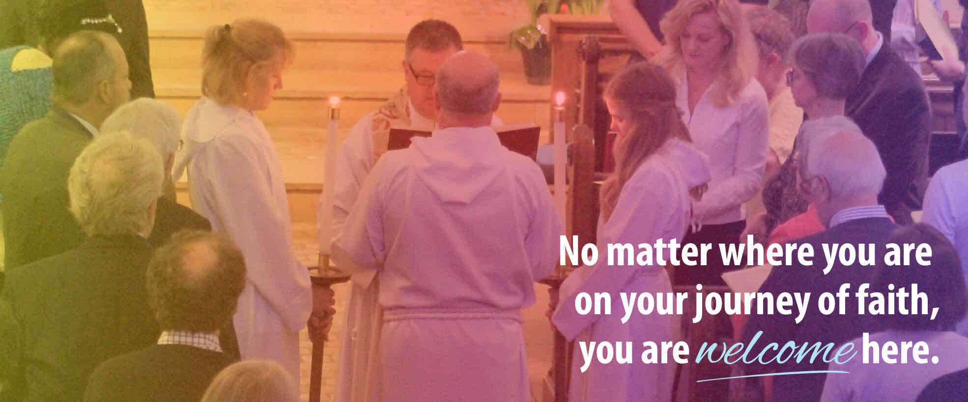 Acolytes with Candles at Easter with 'You are welcome here' text overlay